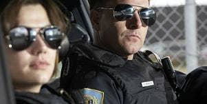female and male cop in cop car
