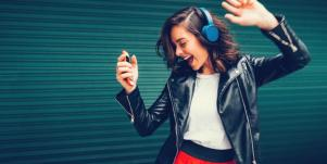 woman dancing with headphones on