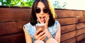 woman texting flirty emoji
