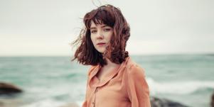 Sad woman by seaside