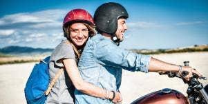 woman grabbing man on bike