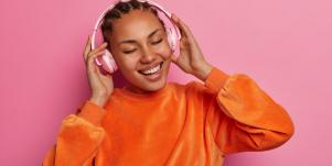 happy girl with headphones on listening to music