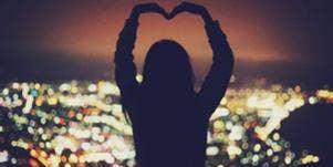 Girl making a heart