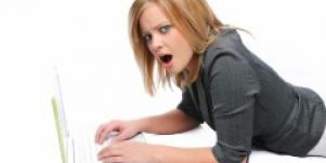 woman with laptop confused by online dating