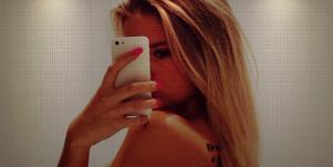 girl taking iphone photo