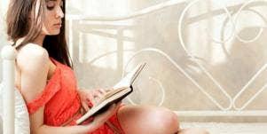 girl reading in bed.