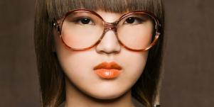 asian woman with large glasses