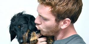 guy kissing dog