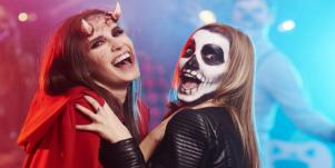women wearing halloween costumes