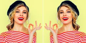 woman making ok sign with hand red striped shirt