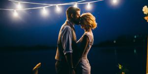 man and woman dancing under lights