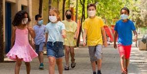 kids walking while wearing masks