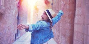 woman dancing down canyon