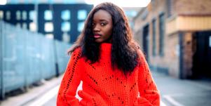 serious woman in red sweater