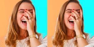 woman laughing with hand on her face