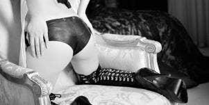 girl's butt in leather BDSM lingerie