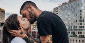man kissing a woman passionately