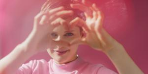 woman in pink channeling her psychic abilities into creativity