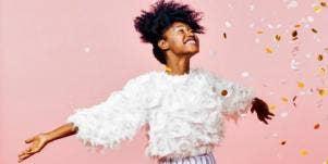 jubilant woman celebrating in confetti