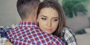 sad couple hugging