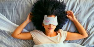 woman in bed with eyemask