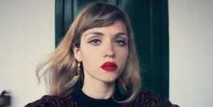 contemplative woman wearing red lipstick