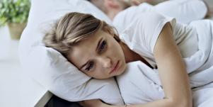 woman sad in bed