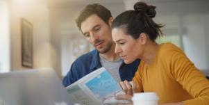 woman and man looking at map