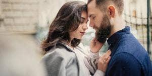 woman and man embracing