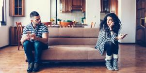sad couple sitting on couch
