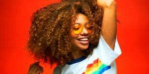happy woman wearing rainbow shirt