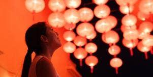 woman looking at chinese lanterns