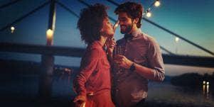 man and woman dancing at dusk