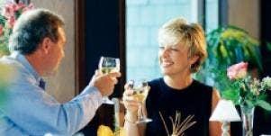 man woman toasting dinner friends