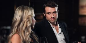 man in suit looking at blonde woman