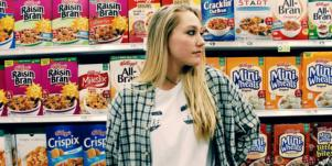 girl in cereal aisle