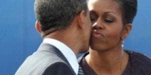 first lady michelle obama president barack obama kissing