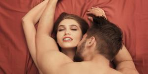 couple in bed having sex
