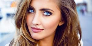 woman with blue eyes staring and smirking