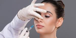 woman getting nose injections