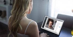 woman looking at computer screen man on screen