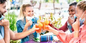 friends toasting drinks outside