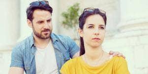 sad looking man and woman