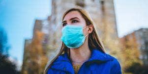 woman wearing a mask outside in city