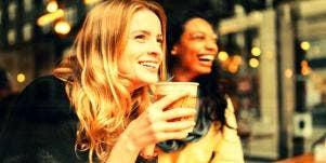 women drinking pumpkin spice latte