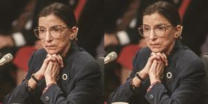 Justice Ruth Bader Ginsburg, in middle age, sits in front of a microphone wearing a grey suit, listening intently