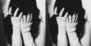 sad girl hiding face