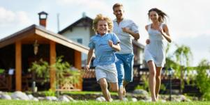 family running outside of a house