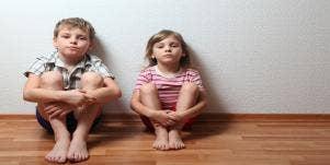 little boy and little girl sitting on floor