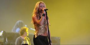 shakira on stage singing